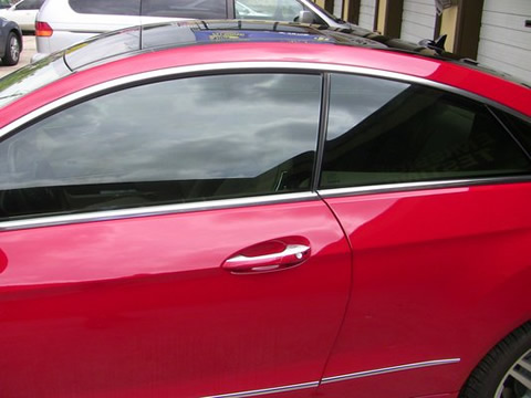 red sports car with tinted windows